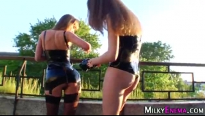 Hot lesbos in latex dildoing